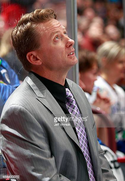Assistant coach Glen Gulutzan of the Vancouver Canucks looks on from the bench during their NHL game against the Washington Capitals at Rogers Arena...