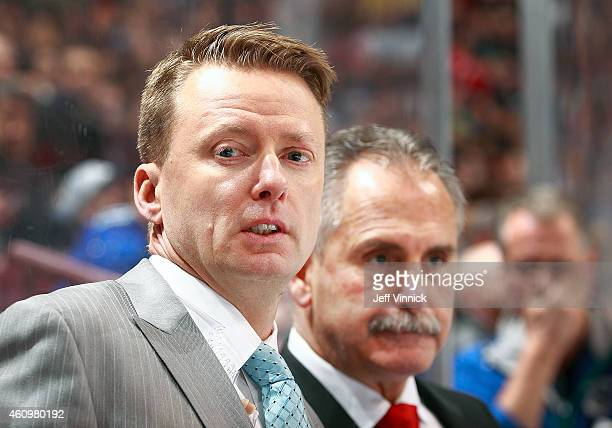 Assistant coach Glen Gulutzan of the Vancouver Canucks looks on from the bench during their NHL game against the Arizona Coyotes at Rogers Arena...