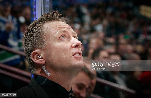 Assistant coach Glen Gulutzan of the Vancouver Canucks looks on from the bench during their NHL game against the Edmonton Oilers at Rogers Arena...