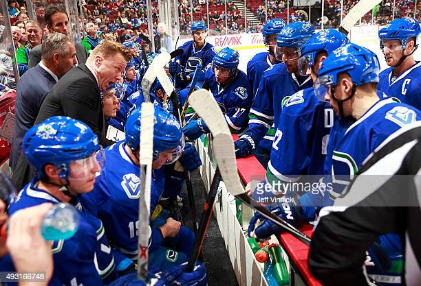 Assistant coach Glen Gulutzan of the Vancouver Canucks talks to players during their NHL game against the St Louis Blues at Rogers Arena October 16...