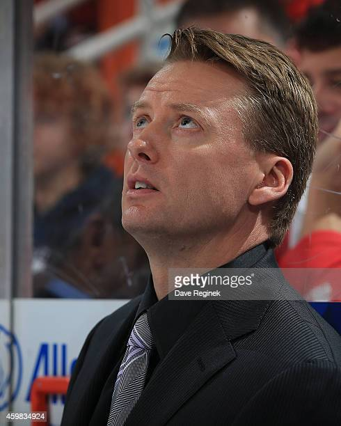 Assistant coach Glen Gulutzan watches the action from the bench during a NHL game against the Detroit Red Wings on November 30 2014 at Joe Louis...