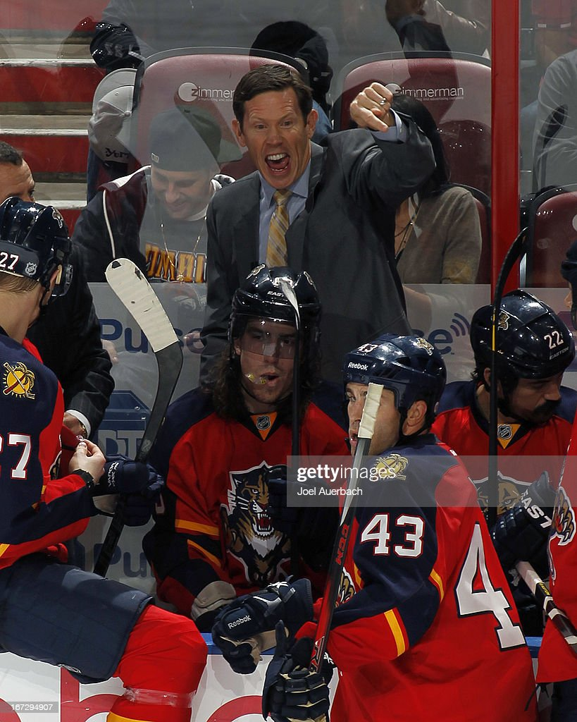 Assistant coach Gord Murphy of the Florida Panthers yells at a game official during a break in action against the New York Rangers at the BB&T Center on April 23, 2013 in Sunrise, Florida. The Panthers defeated the Rangers 3-2.