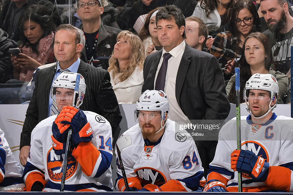 Assistant Coach Greg Cronin left and Head Coach Jack Capuano of the New York Islanders right watch their team play against the Columbus Blue Jackets...