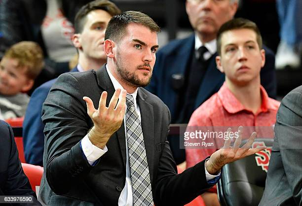 Assistant coach Greg St Jean of the St John's Red Storm reacts against the Delaware State Hornets during the second half at Carnesecca Arena on...