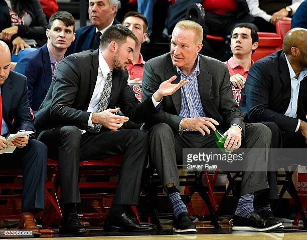 Assistant coach Greg St Jean talks with head coach Chris Mullin of the St John's Red Storm against the Delaware State Hornets during the second half...