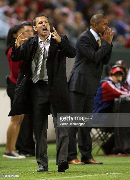 Assistant Coach Greg Vanney and Head Coach Robin Fraser of Chivas USA yell instructions to their players on the field in the second half during their...