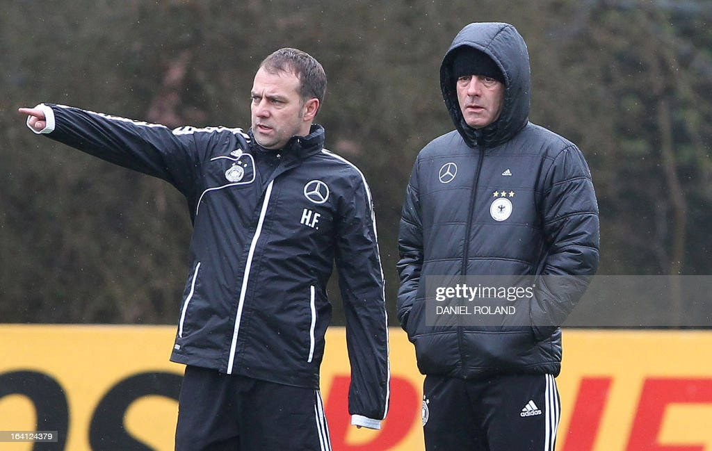 Assistant coach Hansi Flick (L) and coach Joachim Loew of the German national football team attend a training session prior to the World Cup qualifyer against Kazakhstan in Frankfurt, Germany, on March 20, 2013.