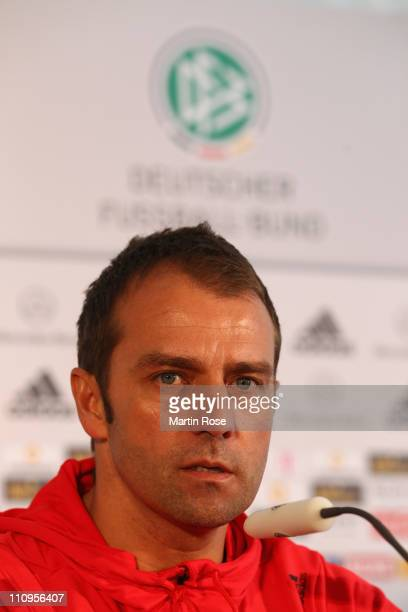 Assistant coach Hansi Flick talks to the media during a press conference of the German national football team ahead of their international friendly...