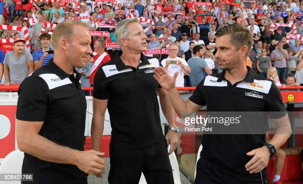 Assistant coach Henrik Pedersen coach Jens Keller and assistant coach Sebastian Boenig of 1 FC Union Berlin before the game between Union Berlin and...