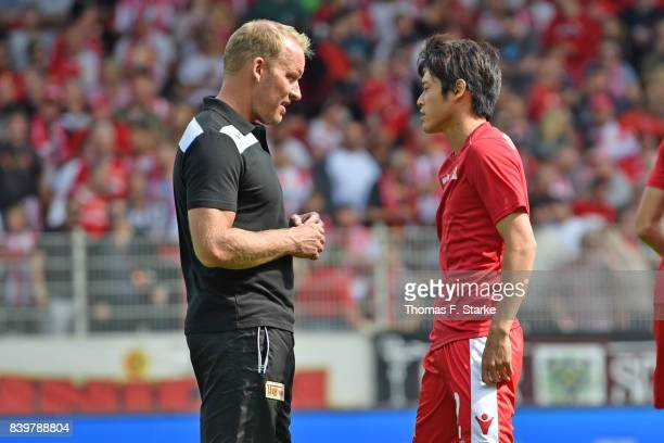 Assistant coach Henrik Pedersen of Berlin talks to Atsuto Uchida prior to the Second Bundesliga match between 1 FC Union Berlin and DSC Arminia...