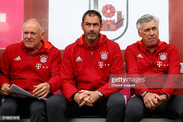 Assistant coach Hermann Gerland assistant coach Paul Clement and head coach Carlo Ancelotti of Bayern Muenchen sit on the bench during the friendly...