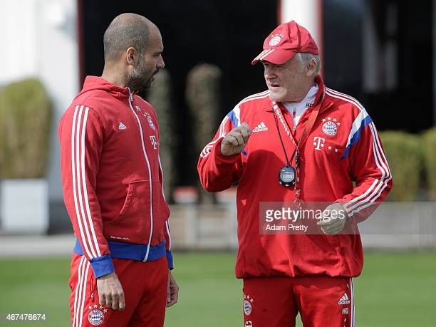 Assistant coach Hermann Gerland speaks to head coach Josep Guardiola during the FC Bayern Munich training session at Bayern's training ground...