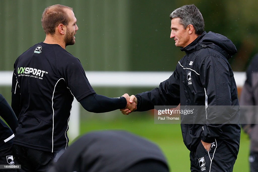 Assistant coach Ivan Cleary (R) of New Zealand shakes hands with Jason Nightingale as he arrives during the New Zealand training session at St Helens Rugby League Cowley training complex on October 23, 2013 in St Helens, England.