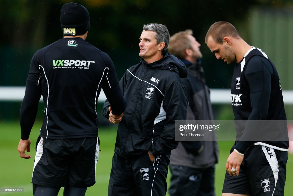 Assistant coach Ivan Cleary (C) of New Zealand shakes hands with Sonny Bill Williams as he arrives during the New Zealand training session at St Helens Rugby League Cowley training complex on October 23, 2013 in St Helens, England.