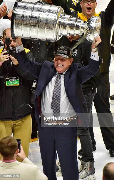 Assistant coach Jacques Martin of the Pittsburgh Penguins celebrates with the Stanley Cup trophy after defeating the Nashville Predators 20 in Game...