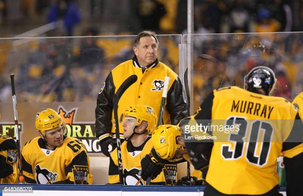 Assistant Coach Jacques Martin of the Pittsburgh Penguins looks on from the bench area during the third period of the 2017 Coors Light NHL Stadium...