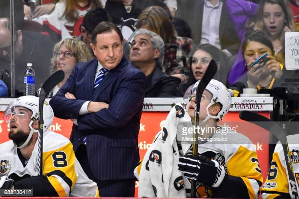 Assistant coach Jacques Martin of the Pittsburgh Penguins looks on against the Ottawa Senators in Game Six of the Eastern Conference Final during the...