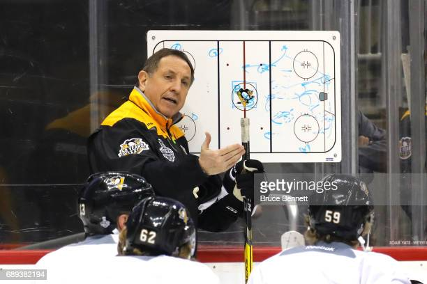 Assistant Coach Jacques Martin of the Pittsburgh Penguins talks with the team in practice during Media Day for the 2017 NHL Stanley Cup Final at PPG...