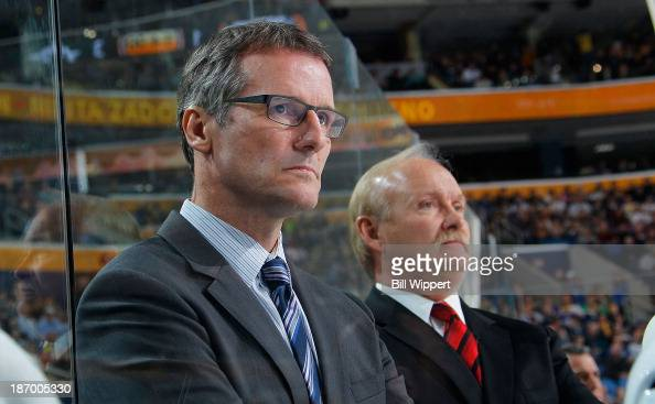 Assistant coach James Patrick and head coach Lindy Ruff of the Dallas Stars watch the action in their return to Buffalo for a game against the Sabres...