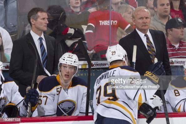 Assistant coach James Patrick and head coach Lindy Ruff of the Buffalo Sabres watch the action during an NHL game against the Ottawa Senators at...