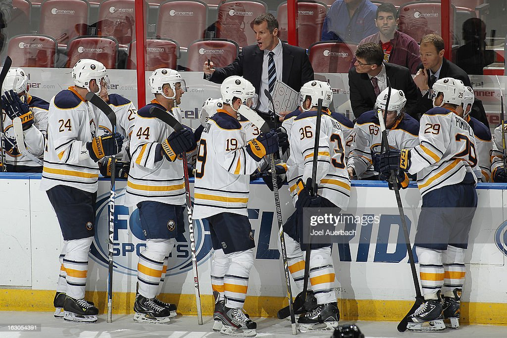Assistant coach James Patrick of the Buffalo Sabres talks to the players during a time out against the Florida Panthers at the BBT Center on February...