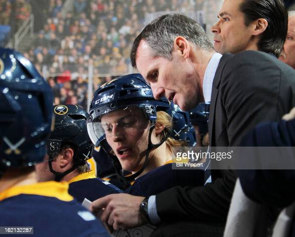 Assistant coach James Patrick of the Buffalo Sabres talks to Tyler Myers in a game against the Boston Bruins on February 15 2013 at the First Niagara...