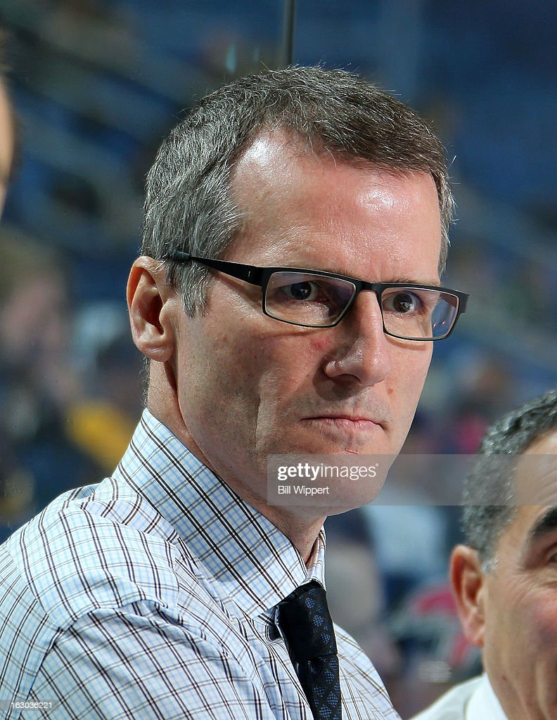 Assistant coach James Patrick of the Buffalo Sabres watches warmups before their game against the New York Islanders on February 23 2013 at the First...