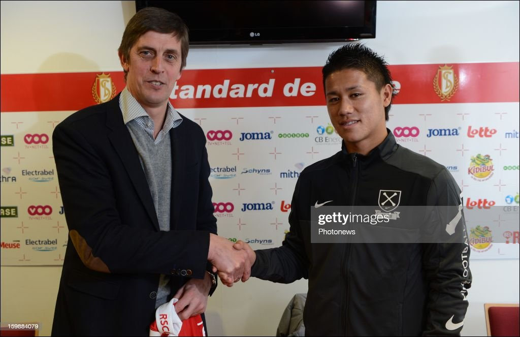 Assistant coach Jean-Francois de Sart poses with Yuji Ono of Standard Liege during press conference to announce his signing to the club on January 22, 2013 in Liege, Belgium.