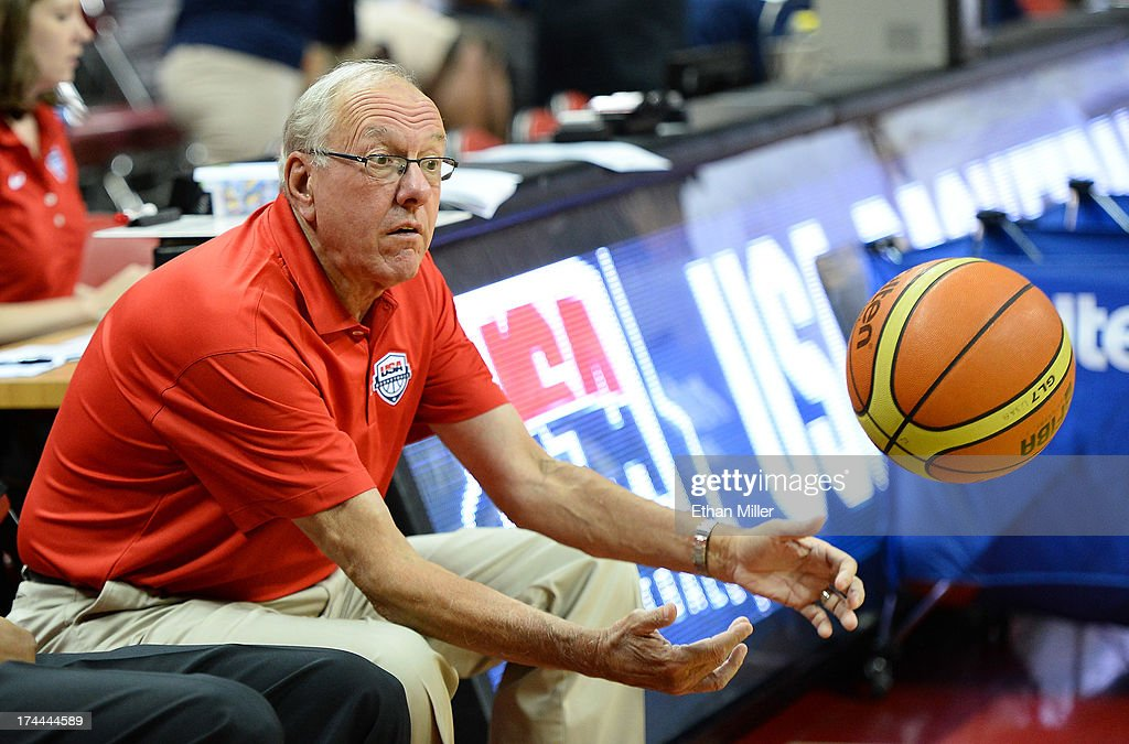 Assistant coach <a gi-track='captionPersonalityLinkClicked' href=/galleries/search?phrase=Jim+Boeheim&family=editorial&specificpeople=210990 ng-click='$event.stopPropagation()'>Jim Boeheim</a> of the 2013 USA Basketball Men's National Team throws a ball back onto the court before a USA Basketball showcase at the Thomas & Mack Center on July 25, 2013 in Las Vegas, Nevada.