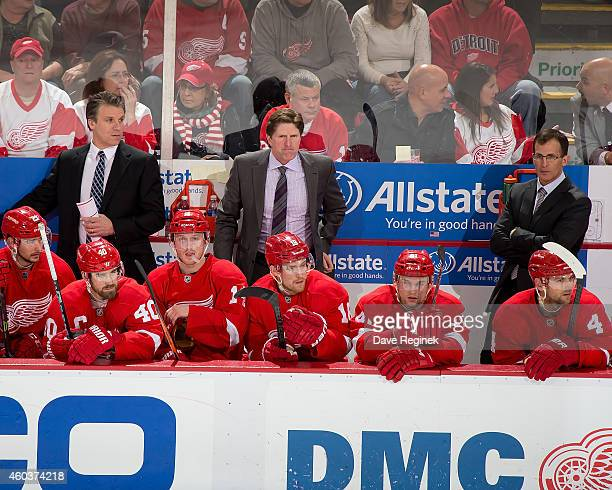 Assistant coach Jim Hiller Head coach Mike Babcock and assistant coach Tony Granato of the Detroit Red Wings watche the action from the bench during...