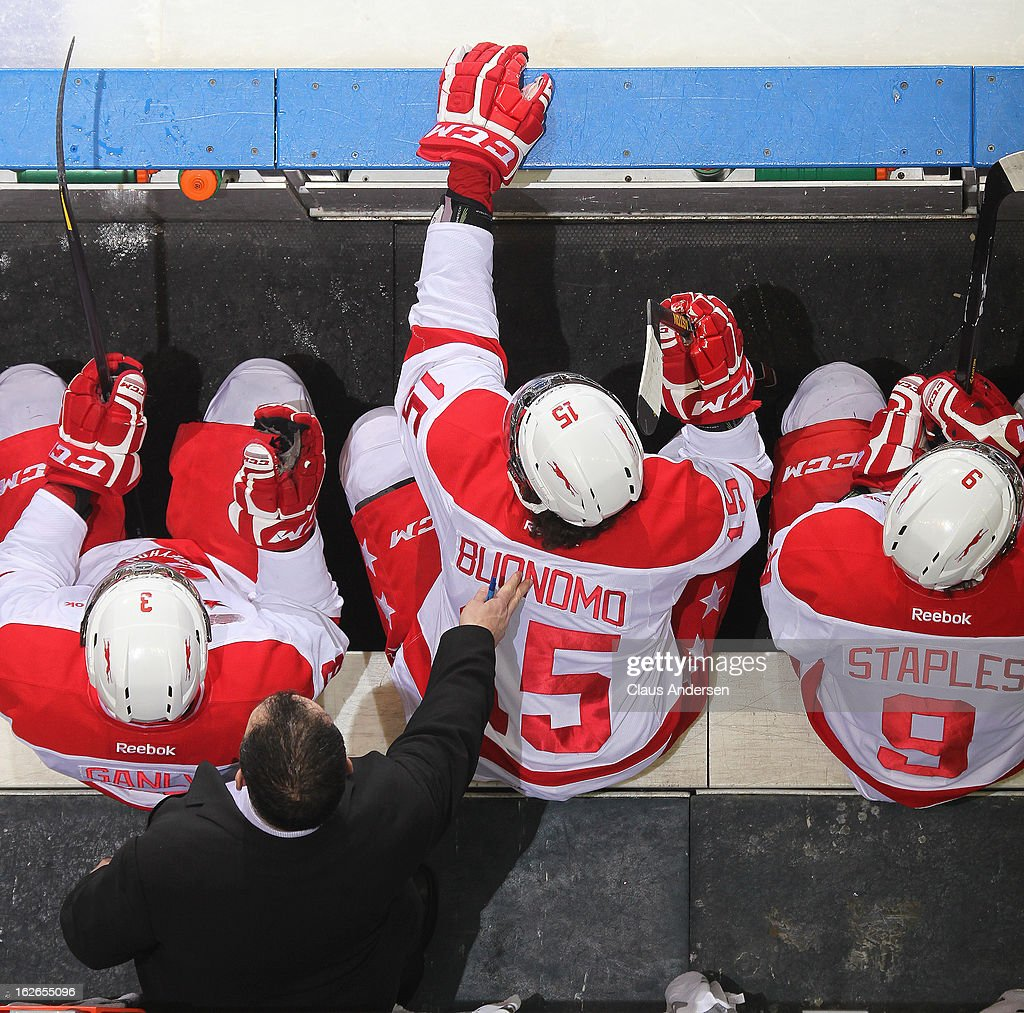 Assistant coach Joe Cirella of the Sault Ste. Marie Greyhounds taps Chris Buonomo #15 on the back in an OHL game against the London Knights on February 22, 2013 at the Budweiser Gardens in London, Ontario, Canada. The Knights defeated the Greyhounds 4-3 in overtime.