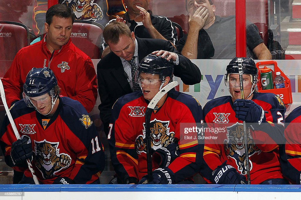 Assistant Coach <a gi-track='captionPersonalityLinkClicked' href=/galleries/search?phrase=John+Madden+-+Hockey+Player&family=editorial&specificpeople=14046726 ng-click='$event.stopPropagation()'>John Madden</a> of the Florida Panthers congratulates <a gi-track='captionPersonalityLinkClicked' href=/galleries/search?phrase=Nick+Bjugstad&family=editorial&specificpeople=7029343 ng-click='$event.stopPropagation()'>Nick Bjugstad</a> #27 on his goal against the Winnipeg Jets at the BB&T Center on December 5, 2013 in Sunrise, Florida.