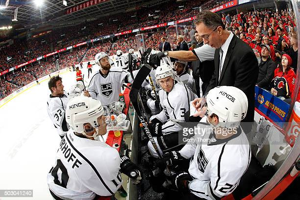 Assistant Coach John Stevens of the Los Angeles Kings instructs his players during an NHL game against the Calgary Flames at Scotiabank Saddledome on...