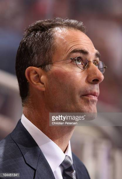 Assistant coach John Stevens of the Los Angeles Kings watches from the bench during the preseason NHL game against the Phoenix Coyotes at Jobingcom...