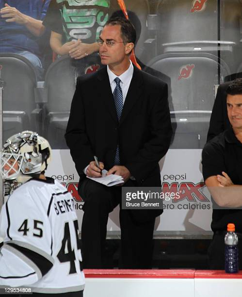 Assistant coach John Stevens of the Los Angeles Kings watches warmups prior to the game against the New Jersey Devils at Prudential Center on October...