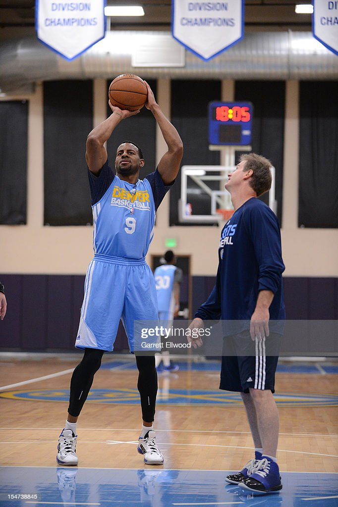 Assistant Coach John Welch works with Andre Iguodala #9 of the Denver Nuggets during practice on October 24, 2012 at the Pepsi Center in Denver, Colorado.