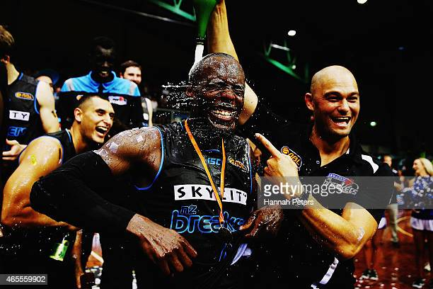 Assistant Coach Judd Flavell of the Breakers pours champagne on Cedric Jackson of the Breakers after winning game two of the NBL Grand Final series...