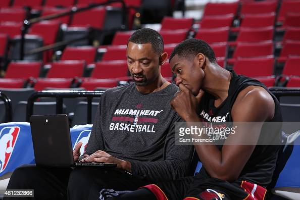 Assistant Coach Juwan Howard looks at film with Hassan Whiteside of the Miami Heat before the game against the Portland Trail Blazers on January 8...