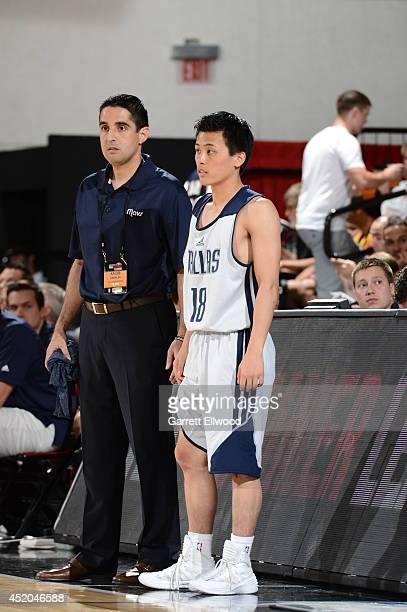 Assistant coach Kaleb Canales of the Dallas Mavericks speaks with Yuki Togashi against the New York Knicks at the Samsung NBA Summer League 2014 on...