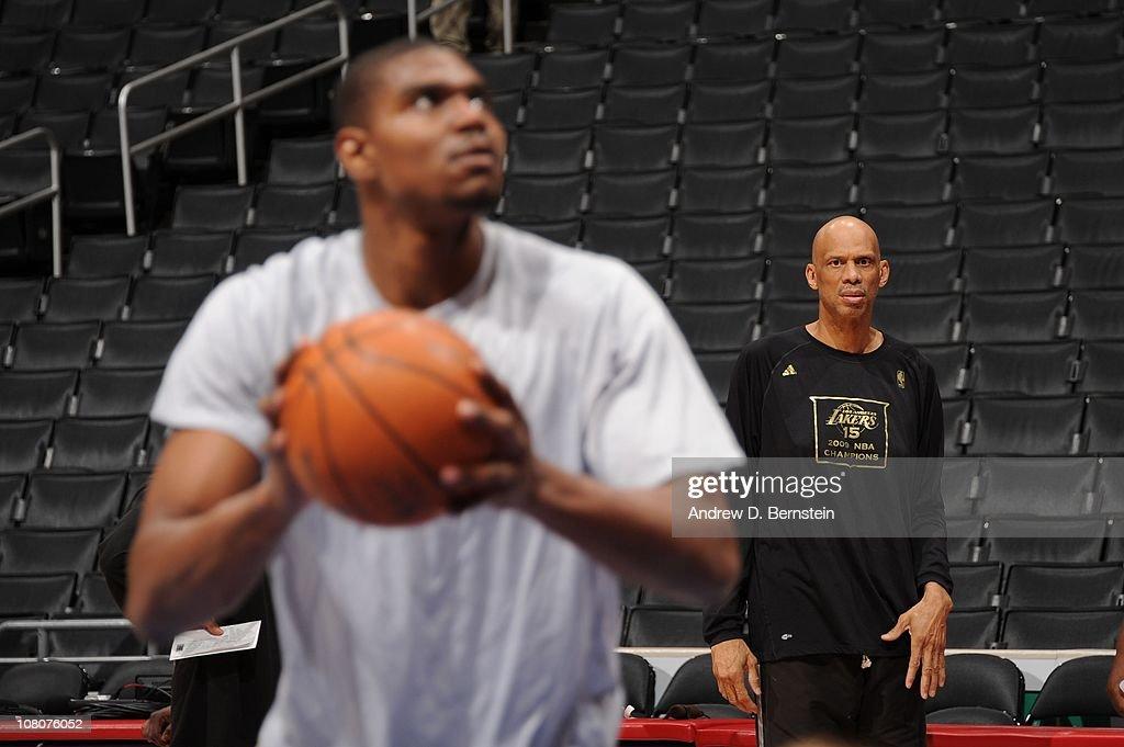 Assistant Coach <a gi-track='captionPersonalityLinkClicked' href=/galleries/search?phrase=Kareem+Abdul-Jabbar&family=editorial&specificpeople=206219 ng-click='$event.stopPropagation()'>Kareem Abdul-Jabbar</a> of the Los Angeles Lakers looks on while <a gi-track='captionPersonalityLinkClicked' href=/galleries/search?phrase=Andrew+Bynum&family=editorial&specificpeople=630695 ng-click='$event.stopPropagation()'>Andrew Bynum</a> #17 warms up before their game against the Los Angeles Clippers at Staples Center on January 16, 2011 in Los Angeles, California.