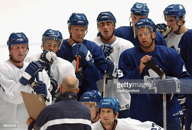 Assistant Coach Keith Acton of the Toronto Maple Leafs goes over a drill with the team during practice at the Globe Arena for NHL Challenge 2003 on...