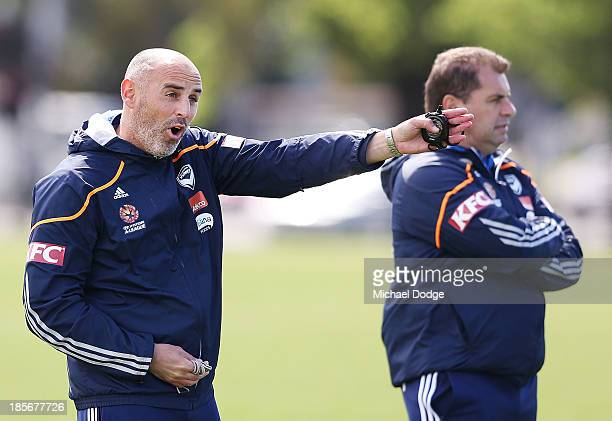 Assistant coach Kevin Muscat gestures next to coach Ange Postecoglou during a Melbourne Victory ALeague training session at Gosch's Paddock on...