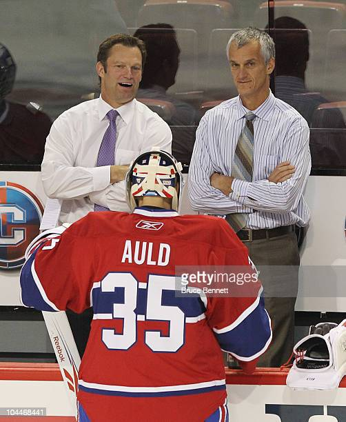 Assistant Coach Kirk Muller speaks with Alex Auld of the Montreal Canadiens prior to the game against the Ottawa Senators at the Bell Centre on...