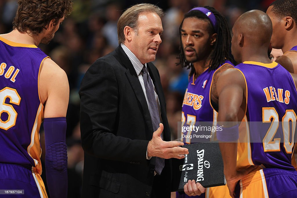 Assistant coach Kurt Rambis of the Los Angeles Lakers directs Pau Gasol Jordan Hill and Jodie Meeks of the Los Angeles Lakers against the Denver...