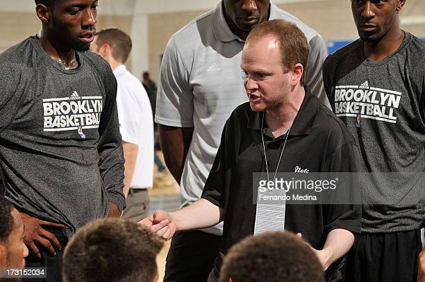 Assistant coach Lawrence Frank of the Brooklyn Nets directs during the 2013 Southwest Airlines Orlando Pro Summer League game between the Brooklyn...