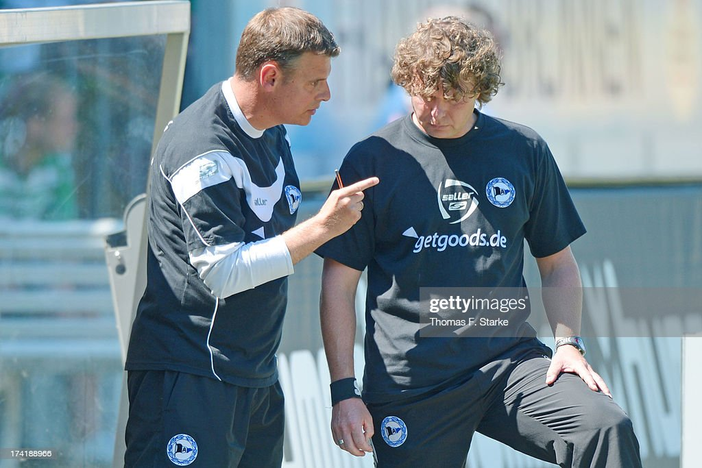 Assistant coach Michael Bauer (L) of Bielefeld talks to head coach Stefan Kraemer during the Second Bundesliga match between Greuther Fuerth and Arminia Bielefeld at the Trolli Arena on July 21, 2013 in Fuerth, Germany.