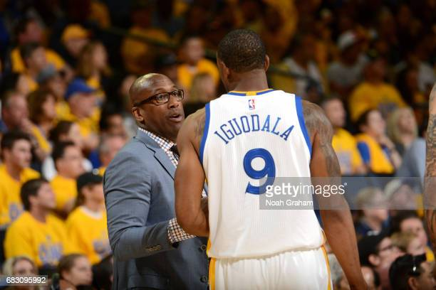 Assistant coach Mike Brown of the Golden State Warriors talks with Andre Iguodala of the Golden State Warriors during the game against the San...