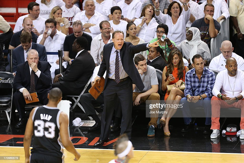 Assistant Coach Mike Budenholzer of the San Antonio Spurs calls a play against the Miami Heat during Game Seven of the 2013 NBA Finals on June 20, 2013 at American Airlines Arena in Miami, Florida.