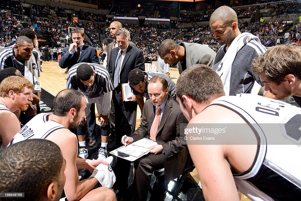 Assistant coach Mike Budenholzer of the San Antonio Spurs draws up plays with his team during a game against the New Orleans Hornets on January 23, 2013 at the AT&T Center in San Antonio, Texas.
