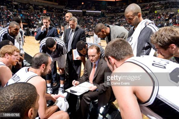 Assistant coach Mike Budenholzer of the San Antonio Spurs draws up plays with his team during a game against the New Orleans Hornets on January 23...